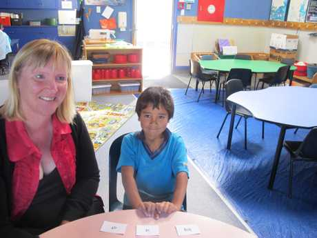 YAY ... GOT IT! Early Word pupil Montarys Munro, 6, and teacher aide Michelle Wood. 071112WCLFSCHOOLS1