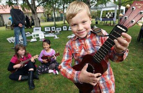 MUSICAL TRIO: Rotorua ukulele students (from left) Hannah Muir, 9, Hannah Seo, 7, and Jason Grey (foreground), 6, played to the crowd outside RAVE during the Ukulele Festival yesterday.