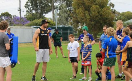 TOP TUTOR: Chiefs captain Craig Clarke runs some Dalby players through a coaching clinic.