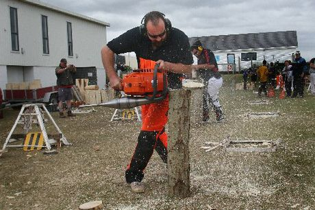 IN THE ROUND: Troy Bellamy, from the Marton Axeman's Club, uses a chainsaw to cut discs from a post in a new event for the Wanganui A & P Show. At rear is Patrick Barrett, from Otaki.PHOTO/ BEVAN CONLEY 111112WCBRCAN02
