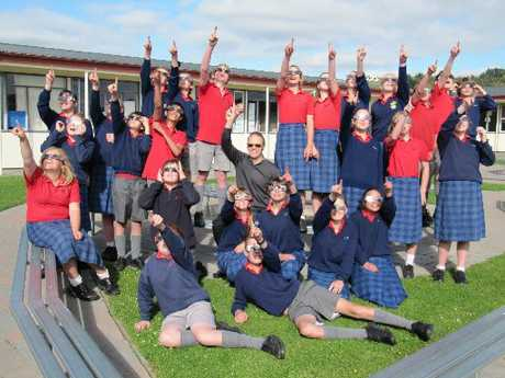 SAFEGUARD: Year 8 Oamaru Intermediate School class wear glasses that will allow for safe viewing of the eclipse. Pictured with them is Dave Roberts, from Visique Oamaru Optometrist. PHOTO/SUPPLIED.