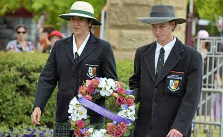 Scots PGC College girls boarding captain Shannon Kreidemann and boys boarding captain Stephen Turnbull lay a wreath at the Cenotaph yesterday.