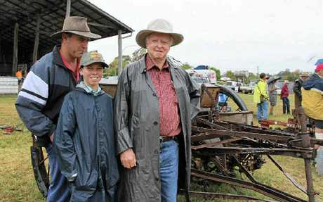 (From left) Kerry, Chris and John O'Mara with their new shearer combine at the Woodcutters clearance sale on Saturday.