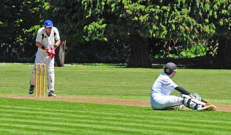 STRANDED: Wairarapa batsman Alex Treseder slips mid-track and watches Wanganui&#39;s Ben Smith remove the bails to run him out.