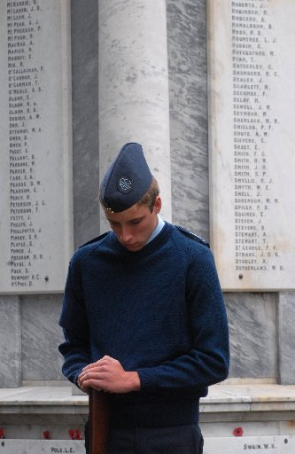 VIGIL: Sergeant Isaac Milne, of the 21 Squadron Air Training Corps in Masterton, stands vigil at the Cenotaph in Queen Elizabeth Park, where more than 100 returned services personnel, their families and friends gathered to remember fallen Kiwi soldiers as part of the Armistice Day service yesterday.