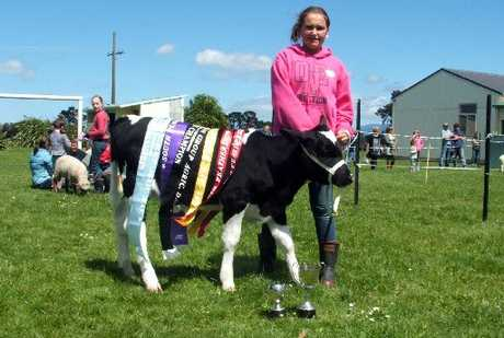 CHAMPION: South Featherston School student Camryn Scott with her supreme champion calf.