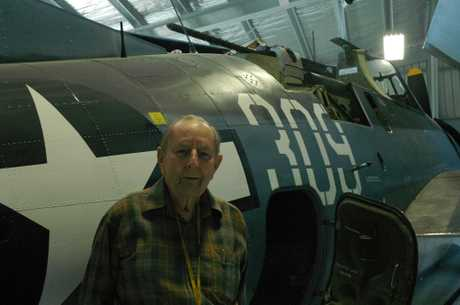 HISTORIC: World War II fighter pilot Neil Manssen with the Grumman Avenger, soon to be repainted in RNZAF colours. PHOTO/ZAC YATES