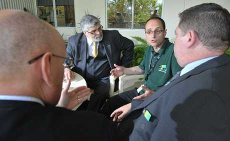 Human Services minister Kim Carr (left) chats with Community recovery &quot;Green Army&quot; member Con Kapoulas, MP Shayne Neumann and Ipswich Centrelink manager Tony Perera at a morning tea to thank staff for their effort during the 2011 flood. 