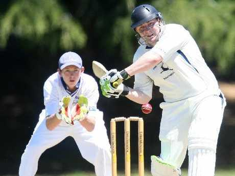 Central batsman Pat Wheelens looks to smash the ball to the boundary during his team's match against Western Heights High School.
