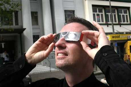 SAFE WATCH: Wanganui optometrist Kerry Bennett tries out a pair of solar viewing glasses. PICTURE/BEVAN CONLEY