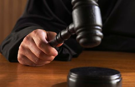 A Te Puke couple are on trial defending charges relating to a gunpoint robbery