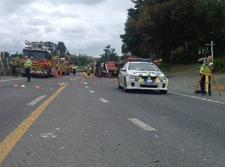 Emergency workers at the scene of a fatal crash south of Whangarei, involving two cars and a logging truck.