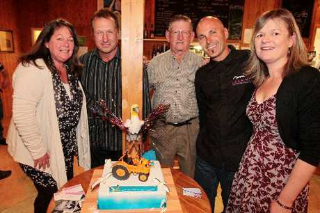 TOURISM MILESTONE: Former Gannet Beach Adventures owners Dayna Hildreth-Heaps (left), Rod Heaps and Neil Burden celebrate the business' 60th birthday with current owners Colin and Kim Lindsay at Clifton Bay Cafe. PHOTO/WARREN BUCKLAND HBT124374-01