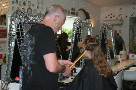 PREPARATION: Tia Betteridge getting her hair measured up for the chop at Ginger Meggs hair salon.