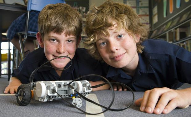Braden Jericho (left) and Jacob Asmussen at the Robogals workshop using computer contolled Lego robots at Martin Luther Primary School, Tuesday, November 13, 2012. Photo Kevin Farmer / The Chronicle