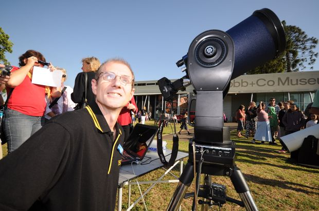 USQ astronomer Rodger McQueen marvels at the partial solar eclipse this morning.
