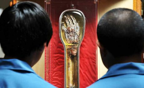 SACRED ARTEFACT: Year 7 students Jordan Prenner and Michael Aiavao get a close look at the holy relic of St Francis Xavier.