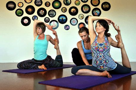 Hannah Bunting (front) and Paige Van de Velde, both 22, enjoy some yoga for health and wellbeing with Lindy Storee Smith at Bloomin Lotus Yoga at Currimundi.