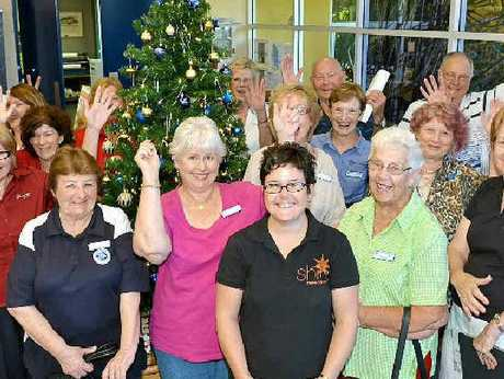 Representatives of charity groups gather at the Adopt-A-Family appeal launch at the Sunshine Coast Daily.
