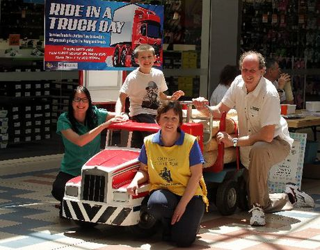MINI MACHINE: Ride in a Truck day supporters are Penny Wood (left) and her son Jacob, Autism NZ Wanganui branch co-chairwoman Sue Kenny and Autism NZ Wanganui branch treasurer Stewart Mead. Fundraising at Trafalgar Square with the help of this model is well under way. PHOTO/STUART MUNRO