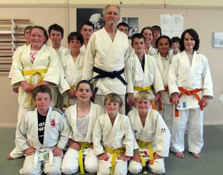 FIRST: Black belt Graham Rogers with students at the Masterton Judo and Ju Jitsu Academy.