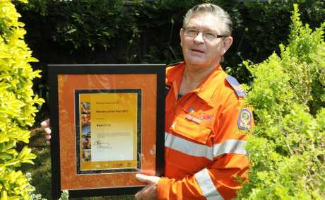 Toowoomba State Emergency Service volunteer Brian Cook celebrates winning the regional member of the year award.
