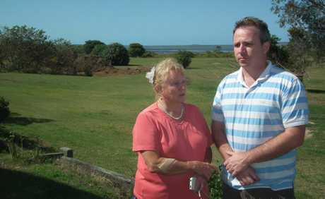 Rosalind Costigan and Sean Huntley from Booral are angry over what they see as a council planning error to allow a house to be shifted near important wetlands.