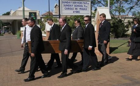 Ophelia Silcox's coffin is carried from St Paul's Anglican Church in Maryborough.