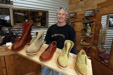 Neville Brunker showing the shoe designs for the Japanese market.