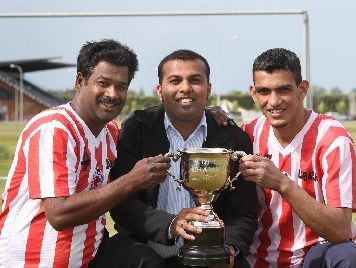 Fiji Cup tournament co-organisers Rudra Naiker and Kranish Singh with Hawke's Bay captain Dilshad Gul sporting the silverware up for grabs on Saturday. Photo / Duncan Brown