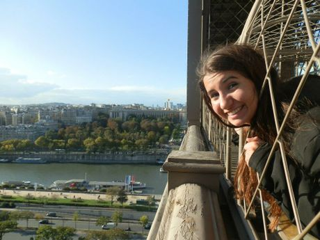 Budding young travel writer Jessie Gretener  at the Eiffel Tower.