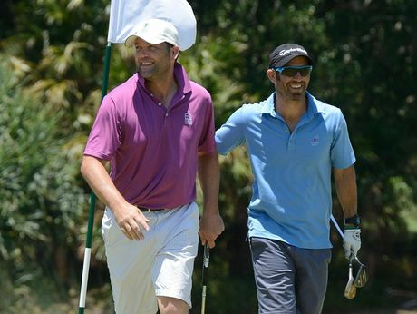 South African cricketer Jaques Kallis (purple shirt) enjoys a round of golf (with an unnamed friend) at the Palmer Coolum Resort. 