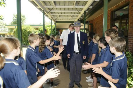 Nathan Essex is congratulated by his school mates at Toowoomba Christian College.