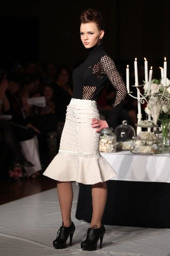 CHIC: First-year designer Tessa Paaymans created a classic peplum hem skirt and a high neck top with mesh sides and sleeves. PHOTO/DUNCAN BROWN HBT124405-36