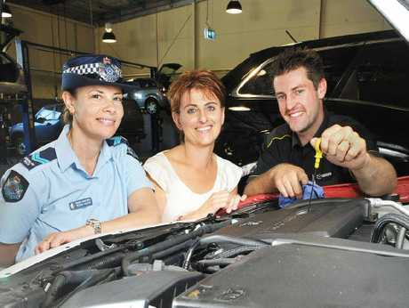 UNDER THE HOOD: Senior Constable Kerrin Sheedy, motorist Sophie Dowe and mechanic Matt Crook run through some basic car maintenance tips ahead of the program to be held at Ian Boettcher Mazda.