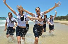 SPLASHIN' OUT: Some of the Mountain Creek High School Year 12 students who took to Mooloolaba Beach to mark their final day at school.