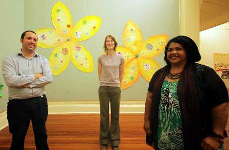 PASIFIKA STYLE: Greg Donson and Sietske Jansma from the Sarjeant Gallery and Silo Naqasima from the Frangipani Pan Pasifika Trust with some of the artwork that will be on display at the gallery over the weekend.