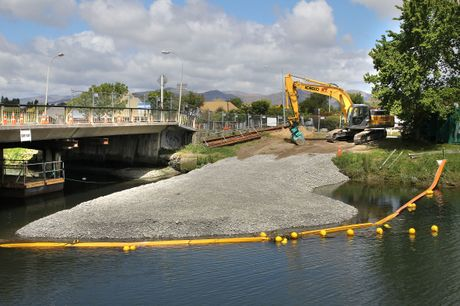 SHINGLE PATH: Work has begun on the Avondale Bridge as a shingle path leads into the Avon River so heavy machinery can begin work on the centre piles.