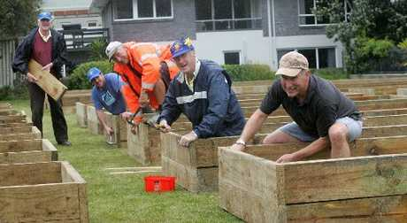 The Lions Club of Mount Maunganui and volunteers help build a community garden in the May St Reserve; Eric Judson (left), Tim Millar, Ken Wilkinson, Brian Dey and Peter Martelletti. 