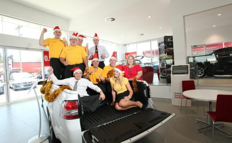 Team from Holden Motorama Springwood with Julie Fursey from the Logan East Community Neighbourhood Association. Photo: Inga Williams / The Reporter