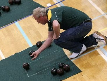 Owhata Indoor Bowls Club member Phillip Stirrup in action against North Harbour.