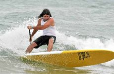 """Dog Man"" Roger Saunders gives it his best shot in the paddleboard event."