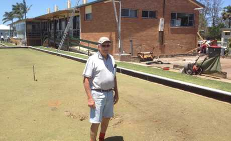 Woodburn Bowling Club president John Forshaw pictured on one of the greens damaged by Saturday&#39;s storm. To his right is the slab that used to sit under the club&#39;s shed.