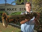 Senior Constable Luke Catt with the mystery Saxophone Photo: Blainey Woodham / Daily News