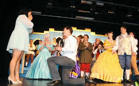 Jo Hay accepts David Anderson's proposal to the delight of the Beauty and the Beast cast. Photo: Bruce MacDougall