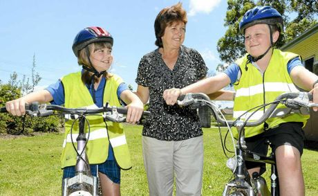 Finnlay Naylor, 9 and Quinn Naylor, 11 with principal Sue Chappele of Cowper Public School. Photo: Adam Hourigan