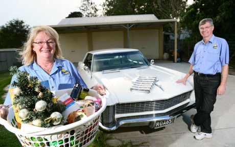 HELPING HAND: Buick Car Club of Australia members Laurene and John Forster of Woodend are supporting the Adopt-a-Family appeal.