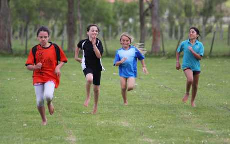 RUNNING HARD: Taking part in a Far North Zone athletics final are, from left, Channell Farry-Wilson, of Peria; Chloe Hayward, of Pukenui; Hazel Halkyard-Leaf, of Pamapuria; and Awhina Oerene, of Kaitaia Primary.