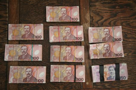 DIRT MONEY: The $100,000 found buried in a paddock at Whangape last week as police closed down a methamphetamine supply ring.