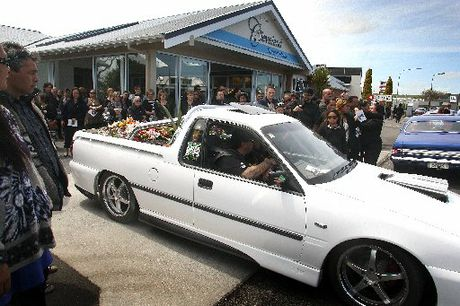 GOODBYE TO A WONDERFUL BOY: A Holden ute carries the casket of Brendon Thompson-Garland, 11.